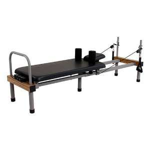 pilates exercise machine with rebounder