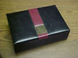 Up for auction here is this vintage black leather men's jewelry box