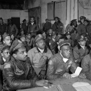 Tuskegee Airmen Attend a Briefing in Ramitelli, Italy, March 1945