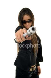 long hair beautiful girl with gun Royalty Free Stock Photo